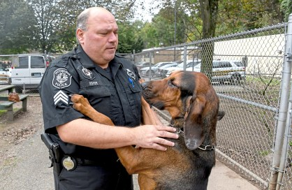 "City of Pittsburgh Police Sgt. Sean Duffy is greeted by ""Cappy"" ,a 19 month old bloodhound ,as he enters the training area at the Pittsburgh Police & Fire Training Academy, near Washington Blvd, Friday Oct. 26, 2018 in Pittsburgh. Duffy is over the K-9 unit which has 18 dogs. Cappy is the newest member of Pgh Police K9 unit. ( Linda Fuoco reporting for Distinctions) (Darrell Sapp/Post-Gazette)"