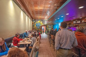 The inside of Taco Diablo with a mural painted by Erich Campbell on the back wall. (Andrew Stein/Post-Gazette)