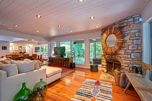 A stone fireplace warms the living space at 400 Meadow Run Road in Farmington. (Piatt Sotheby's)