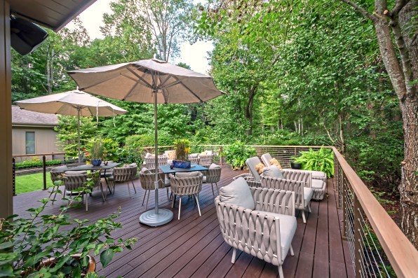 The large deck offers views of some of the 20-acre property. (Piatt Sotheby's)