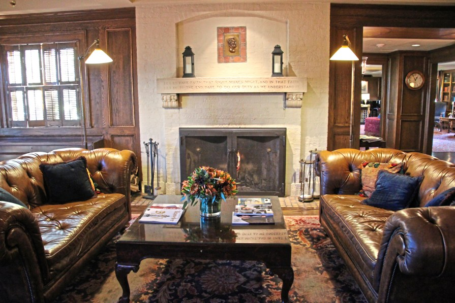 A fireplace with a quote from Abraham Lincoln carved into the mantel makes a cozy nook in the American Club hotel, Kohler, Wisconsin. ( Patricia Sheridan/Post-Gazette)