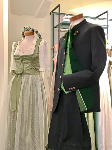 Traditional Tyrolian dress and a loden jacket in a shop window in Vienna. (Patricia Sheridan/Post-Gazette)