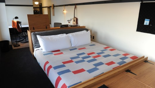 A suite guest room at the Ace Hotel with a craftsmen-inspired platform bed with a Pendleton blanket designed by Atelier Ace at the Ace Hotel in East Liberty on Thursday, December 10, 2015. (Rebecca Droke/Post-Gazette)