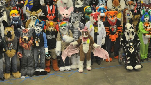"""Furries"" pose for a group photo at the 2014 Anthrocon Annual Convention at the David L. Lawrence Convention Center in downtown Pittsburgh, PA. (Tony Tye/Post-Gazette)"