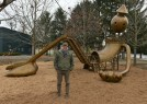 "Artist Tom Otterness with his sculpture ""Playground"" at the Aspinwall Riverfront Park."