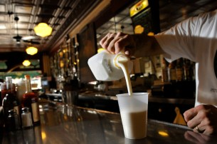 At the Original Oyster House on Market SquareRick Faust pours a glass of buttermilk. Regulars at the Oyster House have been drinking buttermilk since Prohibition, when beer wasn't available. Many believed buttermilk coated and protected their stomachs. (Steve Mellon/Post-Gazette)