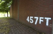 A portion of the outfield wall of Forbes Field still stands in Oakland. (Darrell Sapp/Post-Gazette)