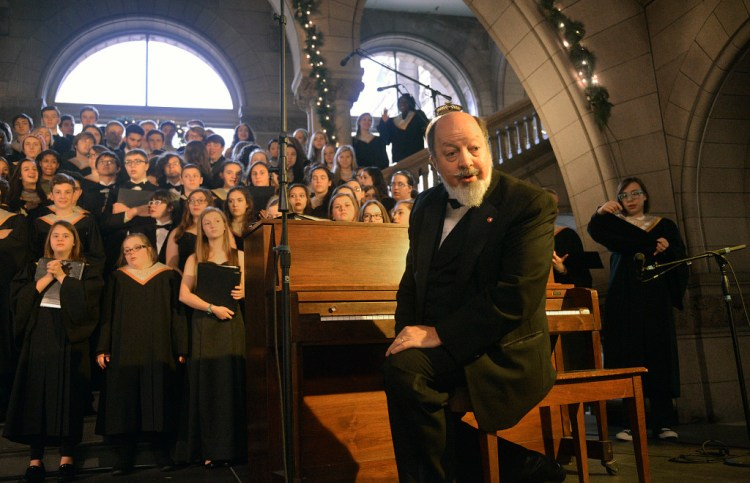 Matthew Boice, director of the  Quaker Valley High School Concert Choir, speaks to the audience before the chorus' 48th consecutive appearance  kicking off in the holiday choral performances at the Allegheny County Courthouse, December 1, 2015. Larry Roberts/Post-Gazette