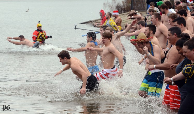 "Participants jump into the Ohio River for the ""Polar Plunge,"" a fundraiser for the Special Olympics Saturday, Dec. 12, 2015, on the North Side. Julia Rendleman/Post-Gazette"