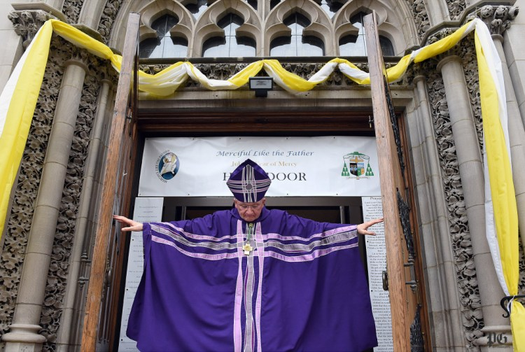 Pittsburgh Roman Catholic Bishop David Zubik opens the Holy Door at St. Paul Cathedral marking the beginning of the Jubilee Year of Mercy in the Catholic Church. Bob Donaldson/Post-Gazette