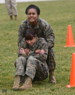 During the administration of the U.S. Marines' combat fitness test ( CFT) in Point State Park, Sgt. Kemmala Kelsey, who is stationed at the recruiting office in Pittsburgh, lifts civilian volunteer, Lisa Thomas, before having to carry her, December 14, 2015. Administering the test was Marine Sgt. Pedro Cardenas . (Larry Roberts/Post-Gazette )
