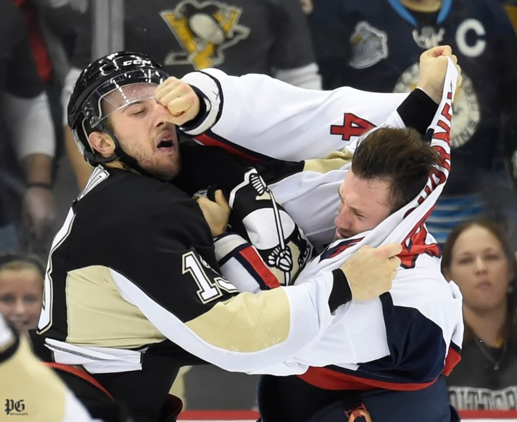 Penguins Nick Bonino takes a right to the face by Washington Capitals Taylor Chorney in the second period on Monday, Dec. 14, 2015, at the Consol Energy Center.