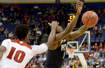 Matt Freed/Post-Gazette Wisconsin's Nigel Hayes gets a piece of Pitt's Jamel Artis as he goes for the ball in the first half Friday of the first round of the NCAA tournament in St. Louis.