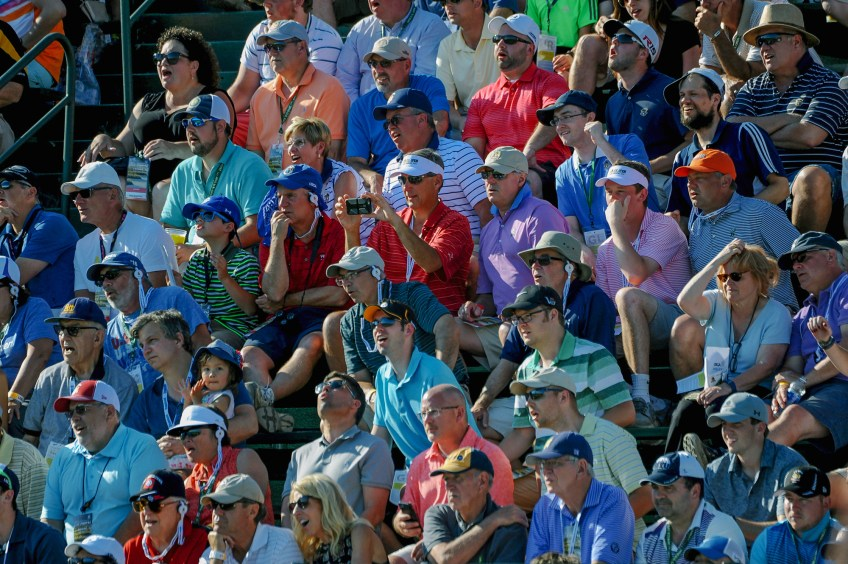 Fans react as they watch a putt on hole 6 during Round 2. (Rebecca Droke/Post-Gazette)