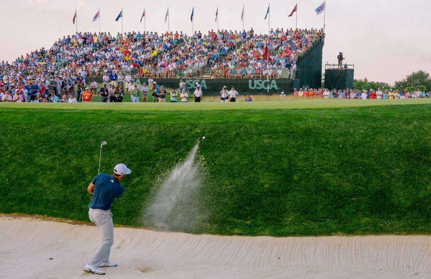 Dustin Johnson hits out of a bunker to the 17th green. (Matt Freed/Post-Gazette)