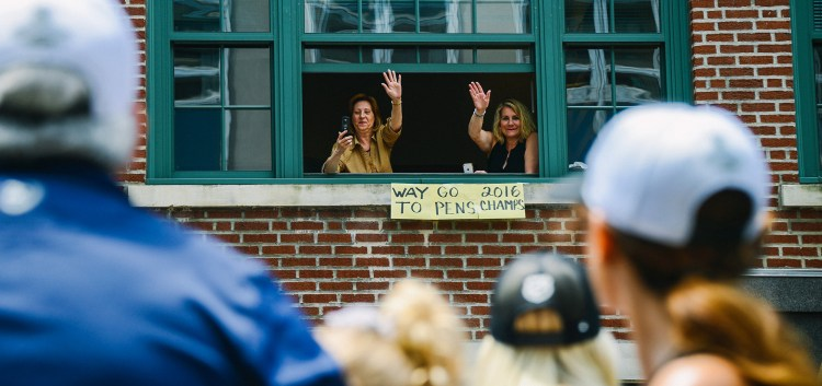 Fans watched from Downtown office buildings. (Rebecca Droke/Post-Gazette)