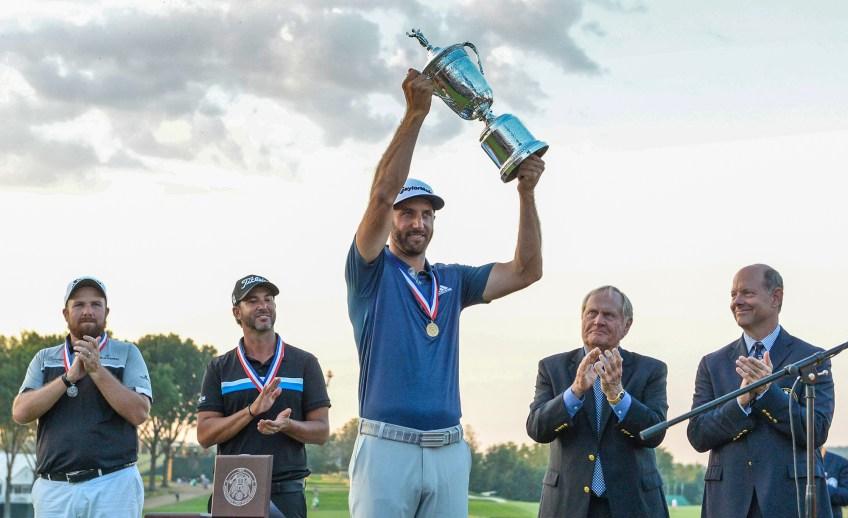 Dustin Johnson hoists the trophy on the 18th green Sunday after winning the U.S. Open. (Matt Freed/Post-Gazette)