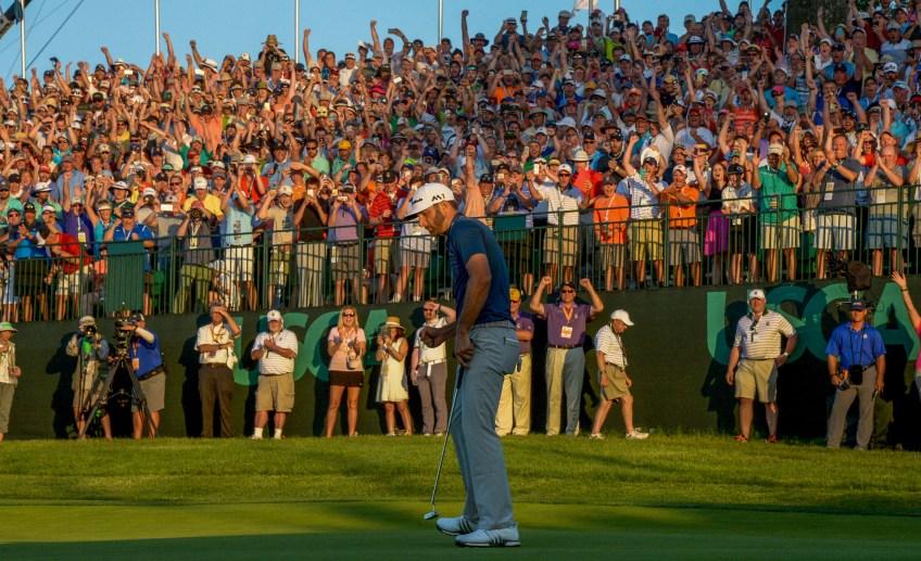 Dustin Johnson celebrates after putting on the 18th green Sunday to win the U.S. Open at Oakmont. (Matt Freed/Post-Gazette)