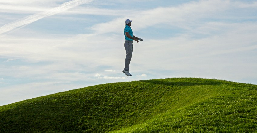 Jason Day jumps up to see where he's aiming for on the third hole during the third round on Saturday. (Matt Freed/Post-Gazette)