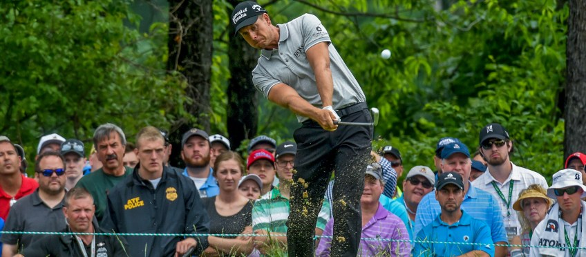 Henrik Stenson hits off the13th tee Friday during the continuation of the first round. (Matt Freed/Post-Gazette)