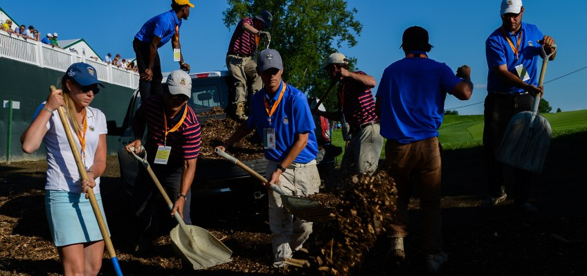 An operations crew adds mulch to a treacherous spot along the pathway near hole 3 on Friday. (Rebecca Droke/Post-Gazette)