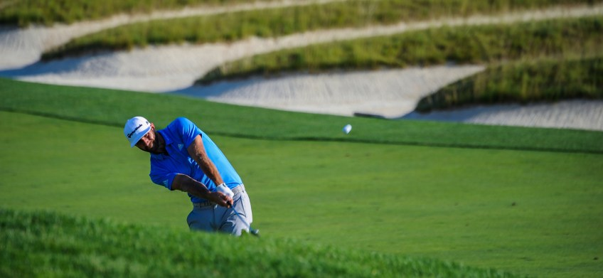 Dustin Johnson sends the ball to the third hole during Round 2 on Friday. (Rebecca Droke/Post-Gazette)