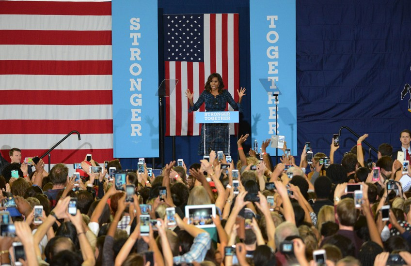 First Lady Michelle Obama campaigns on behalf of Democratic presidential candidate Hillary Clinton at the Fitzgerald Field House at the University of Pittsburgh.