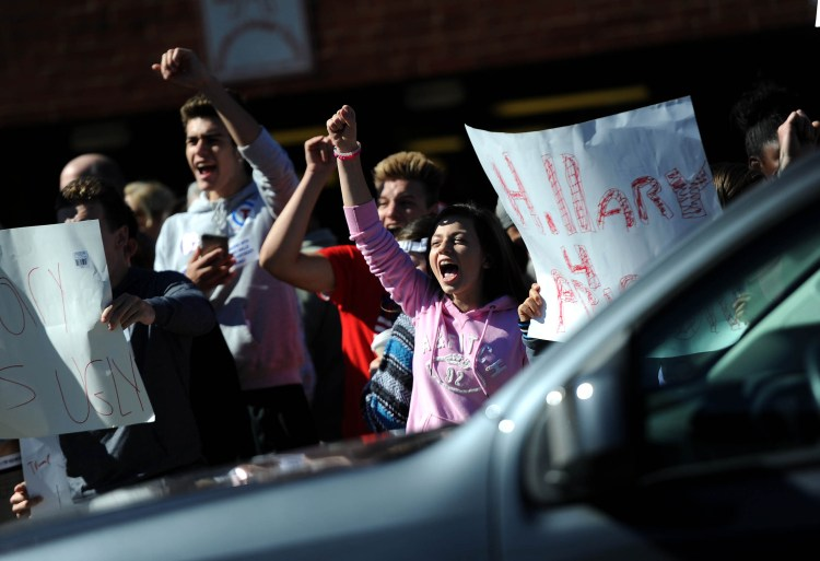 Donald Trump supporters yell at a group of pro-Hillary Clinton protesters gathered across the street while waiting in line to enter Ambridge High School for a Trump campaign event. Michael Henninger/Post-Gazette