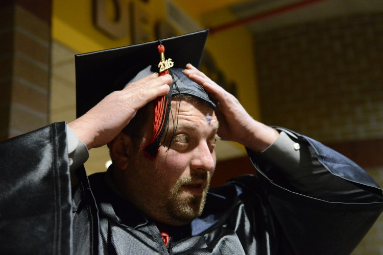 Chris Schiavoni of Beaver Falls adjusts his cap as he prepares to graduate during a ceremony for ITT Technical Institute at Pittsburgh Technical College in Oakdale on Wednesday, October 12, 2016.