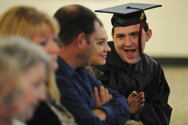 "Rebecca Droke/Post-Gazette--Wednesday, October 12, 2016--STANDALONE LOCAL-- Kalen Bailey of Zelienople jokes around with family and friends before the graduation ceremony for ITT Technical Institute students at Pittsburgh Technical College in Oakdale Wednesday, October 12, 2016. In September ITT abruptedly closed amid a federal inquiry. PTC stepped forward to host a graduation ceremony--which 8 students attended-- providing caps and gowns for graduates. ""Students who graduate deserve to be recognized and through no fault of their own they couldn't. We are proud and happy to do it,"" says PTC president Greg DeFeo abut holding the graduation ceremony."
