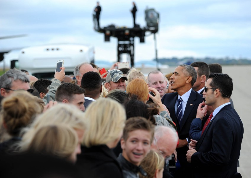 President Barack Obama greets invited guests after landing at the 171st Air Refueling Wing in Coraopolis. (Photo by Michael Henninger/Post-Gazette)