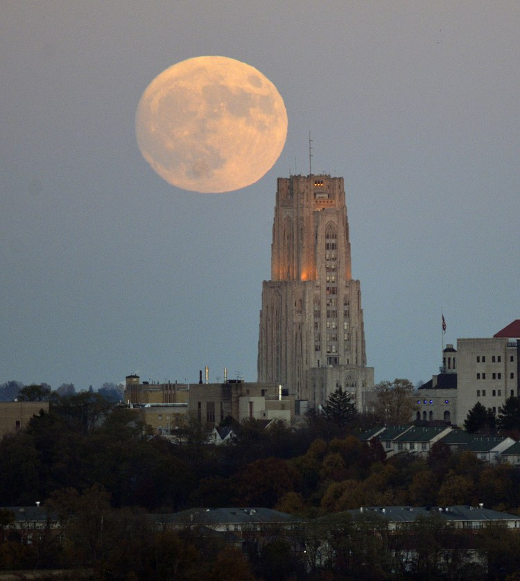 The perigee full moon rises over the Cathedral of Learning in Oakland, November 13, 2016.  The photo was taken from Grandview Ave. on Mt. Washington. (Larry Roberts/Post-Gazette)