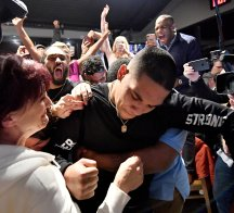 James Conner learns he's a member of the Pittsburgh Steelers during a draft party at Buffalo Wild Wings on April 28, 2017, in Erie, PA. (Matt Freed/Post-Gazette)