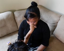 Juana's three-year-old daughter wipes her mother's tears on July 20, 2017, as Juana's describes her ordeal since arriving from Nicaragua. (Nate Guidry/Post-Gazette)