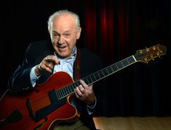 Iconic jazz guitarist Joe Negri poses for a portrait on stage at Duquesne University. (Nate Guidry/Post-Gazette)