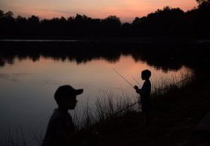 Noah Snyder, 5, from Monroeville, right, and his brother, Bryce, 8, fish at dusk on Thursday, Sept 21, 2017 at Keystone State Park in Derry Township. (Haley Nelson/Post-Gazette)
