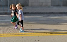 """Gianna Baldonieri, 3, from Brookline and Spencer Dolan, 3, from Churchill run together along North Shore Drive during the 1st annual Lil' Yinzer fun run to """"celebrate the 'Burgh"""" and raise funds for homeless services for Light of Life Mission on Saturday, August 19, 2017 in Pittsburgh. (Pam Panchak/Post-Gazette)"""