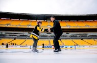 Sixteen-year-old Lily Tarasiewicz, of Chesterfield, S.C., skates with her idol, Mario Lemieux during a private skating session on the Stadium Series rink at Heinz Field arranged by Make-A-Wish on February 27, 2017. Tarasiewicz was diagnosed with Hodgkin Lymphoma, the same cancer that Lemieux was diagnosed with and overcame during his NHL career. This was the second time Tarasiewicz had ever been ice skating. Lemieux was at Heinz Field for the 2017 Mario Lemieux Fantasy Hockey Camp. (Andrew Rush/Post-Gazette)