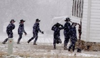Amish Children run during a blistery snow riddled recess outside of a School in Wilmington Township in Mercer County on Tuesday, March 14, 2017. (Darrell Sapp/Post-Gazette)