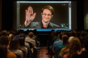 Former CIA employee, NSA contractor, and whistleblower Edward Snowden waves to a full room of Pitt students as he signs on to speak with them live from an undisclosed location on Wednesday, Feb. 1, 2017 at the William Pitt Union Assembly Room on the University of Pittsburgh's Oakland campus. The Pitt Program Council's lecture committee organized a conversation with Snowden exclusively for Pitt students, allowing Snowden time to speak on cyber security and privacy and then take questions submitted by the ticketed students. (Stephanie Strasburg/Post-Gazette)
