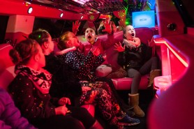 """Girls sing Frozen's """"Let it Go"""" as they drive around in a pink stretch limo during Sweet and Sassy's lights and limo event in Bethel Park on Dec. 29, 2016. Pictured left to right are Mackenzie Downey, 5, of McCandless, Lyla Ostrowski, 8, Alyssa Lips, 7, and Julia Tengowski, 7, all of Peters Township, and Bella Trout, 9, of McCandless. (Stephanie Strasburg/Post-Gazette)"""