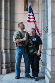 """NRA instructor Marilyn Boulet, left, and her husband, Bill Perkins, of Gibsonia. """"People take offense sometimes just because they don't agree, but that's not what the country's about,"""" said Perkins, who said he came out to show support for the officer and for gun rights. Bouvet, who became a U.S. citizen after growing up in Canada, is now an NRA instructor and a range safety officer. """"Somewhere along the line, you know, with the news I just realized in this great country you can have a fire arm for protection."""" Her sisters don't understand her change. """"They said, oh my gosh, what happened to you? And I said, nothing, and I want to keep it that way."""" (Stephanie Strasburg/Post-Gazette)"""