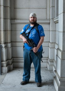 """Brad McWilliams, 40, of North Versailles. """"An officer is being persecuted for standing up for their Second Amendment right, so I'm here sticking up for that officer that didn't do anything wrong."""" (Stephanie Strasburg/Post-Gazette)"""