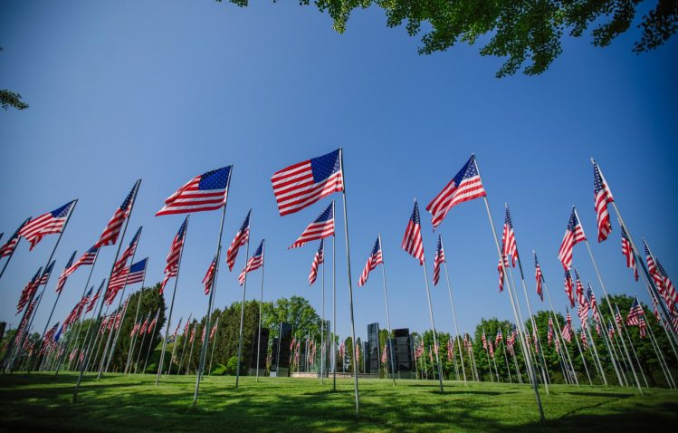 A view of the Avenue of 444 Flags at Hillcrest Memorial Park cemetery on Thursday, May 24, 2018, in Hermitage. The flags were raised during the Iran hostage crisis and mark the 444 days of captivity. (Andrew Rush/Post-Gazette)