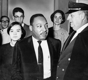Filing past policeman at the University of Pittsburgh are the Rev.Dr. Martin Luther King and others. At left is Peggy Wolak, chairman of the public affairs committee of Pitt's Student Union