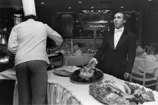 Frank Turi supervises preparation at Park Schenley, Nov. 1984 (Photo by Greg Blackman, The Pittsburgh Press)