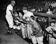 Teammates congratulate Jackie Robinson after a home run at Forbes Field on June 4, 1952. (Pittsburgh Press photo)
