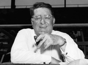 Smiling Branch Rickey with his ever-present cigar