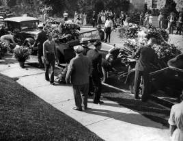 Flowers for the slain mobster filled seven autos. (Pittsburgh Press photograph)