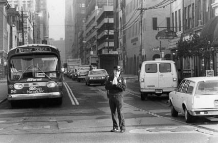 """A Downtown traffic jam without Vic Cianca is a traffic jam with no redeeming qualities."" Nov. 2, 1982. (The Pittsburgh Press photo)"